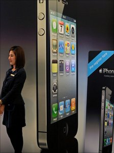 Woman stands by giant iPhone