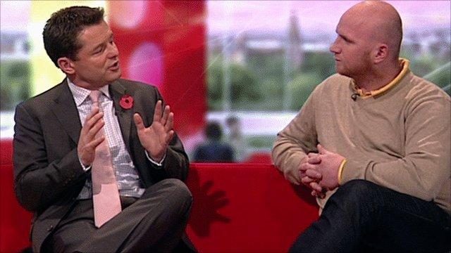 Former Wales striker John Hartson(r) talks to BBC Sport's Chris Hollins(l)