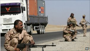 Private security contractors guard a road in the province of Ghazni, Afghanistan, 27 October 2010