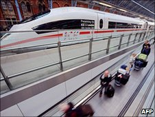 Eurostar passengers pass an ICE high speed train operated by Deutsche Bahn at St Pancas International station, London