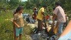 Villagers wrap recovered bodies in plastic in the tsunami-hit Muntei Baru Baru village
