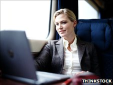 Woman with laptop on a train