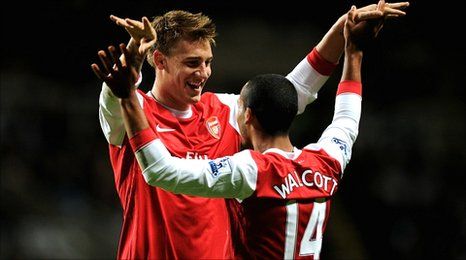 Nicklas Bendtner congratulates Theo Walcott after scoring a controversial goal