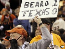 A Giants fan wears a fake beard in honour of pitcher Brian Wilson
