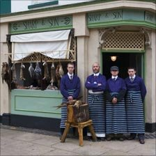 Andrew Sharp, second left, outside his Edwardian era butchery