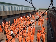Men in the maximum security exercise area of Leeuwkop Prison