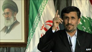 President Mahmoud Ahmadinejad speaking in Beirut with a picture of Iran's Supreme Leader Ayatollah Khamenei behind him