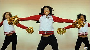Members of the San Francisco 49ers cheerleading team, Gold Rush, perform during a dance clinic in London