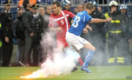 Serbia fans threw missiles on to the pitch during their side's Euro 2012 qualifier against Italy in Genoa on 12 October