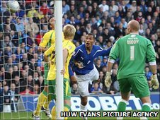 Jay Bothroyd heads an early opening goal for Cardiff as Norwich get a hot reception in the Welsh capital