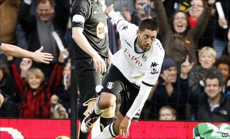 Fulham's Clint Dempsey (right) celebrates his second goal against Wigan