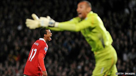 Tottenham goalkeeper Heurelho Gomes (right) protests after Nani struck