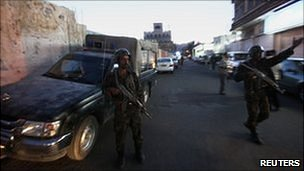Yemeni security forces block a street in the capital Sanaa, 30 October