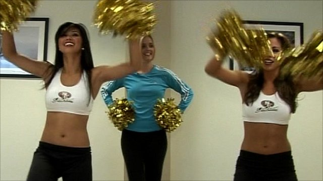 The BBC's Amanda Davies works out with cheerleaders for the San Francisco 49ers
