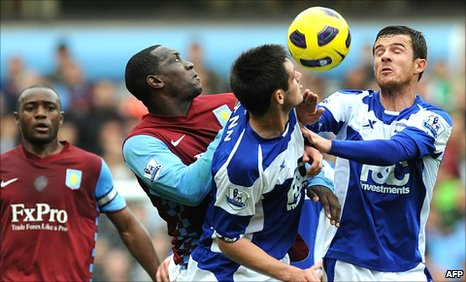 Aston Villa and Birmingham players battle for possession