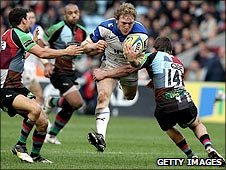 Bath's Sam Vesty is held up by Tom Williams of Harlequins