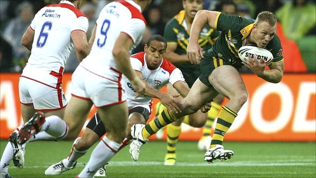 Australia's Luke Lewis breaks through to score Australia's opening try