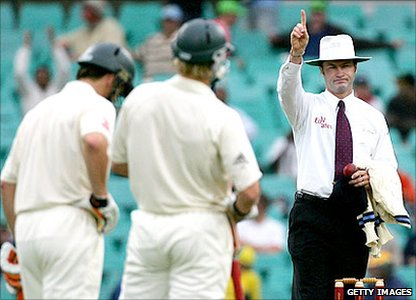 Umpire Simon Taufel gives a batsman out
