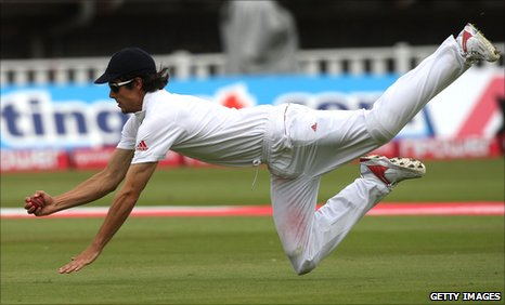England's Alastair Cook takes a diving catch
