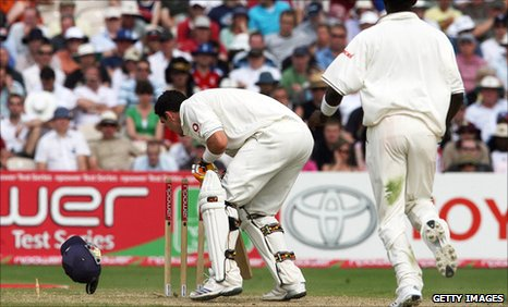 Kevin Pietersen's helmet falls on to the stumps
