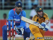 India's Mahendra Dhoni and Australia's Mike Hussey