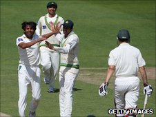 Pakistan celebrate a wicket taken by Mohammad Amir (left)