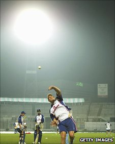 England spinner Ashley Giles bowls under floodlights at net practice in 2003