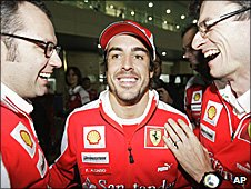 Ferrari team boss Stefano Domenical, Fernando Alonso and chief engineer Chris Dyer