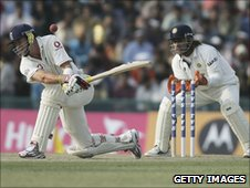 Kevin Pietersen sweeps Harbhajan Singh, but the ball hits his wrist