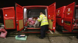 Royal Mail worker unloading bags of post at a sorting office in Bristol