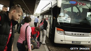 Polish workers boarding bus in Warsaw bound for London - file pic