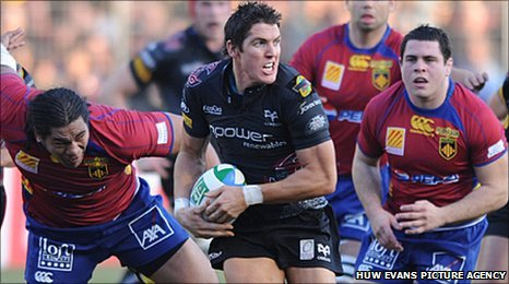 James Hook tries to evade Perpignan's clutches in 2009 in the Heineken Cup