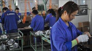 Motorbike factory workers