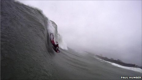 surfer riding the wave