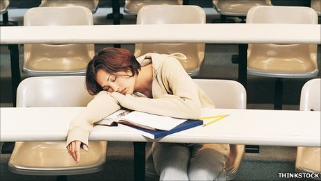 Female student asleep in lecture theatre