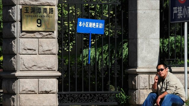 A plainclothes policeman outside Liu Xiaobo's house