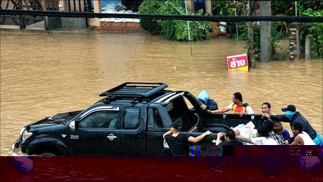 A truck being pushed through flood water on Ko Samui