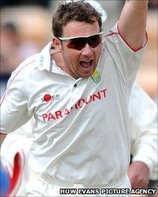 Robert Croft celebrates taking a wicket