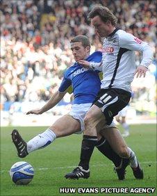 Cardiff's Adam Matthews challenges Swansea's Cedric van der Gun