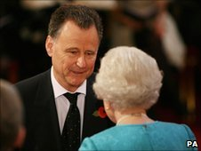 Mike Ingham receives his MBE from the Queen