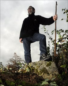 Forestry Commission ranger Andrew Norman rests on the Birklands Stone, thought to be several hundreds years old atop the ancient mound of Thynghowe in Sherwood Forest