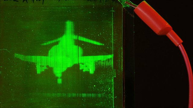 Hologram of toy fighter being printed