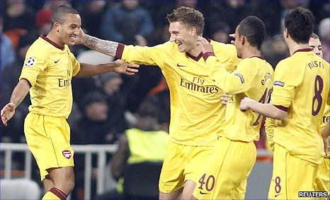 Theo Walcott (left) is congratulated by team-mates after his goal against Shakhtar Donetsk