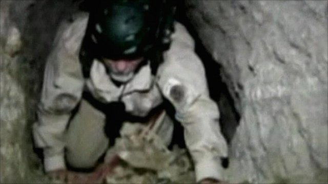 Police officer climbing in tunnel