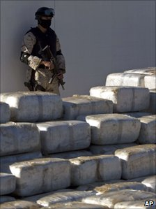 Mexican soldier stands guard by the packets of seized marijuana in Tijuana on 3 November