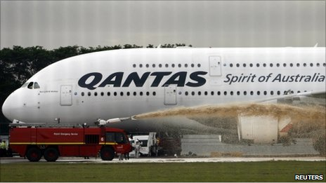 Qantas Airways 380 passenger plane flight QF32 is sprayed by rescue services after making an emergency landing at Changi airport in Singapore November 4, 2010
