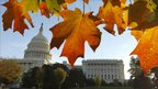 The US Capitol and House of Representatives are seen through autumn foliage on election day in Washington