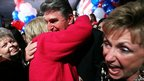 Democratic US Senate candidate and West Virginia Governor Joe Manchin (C) is hugged by a supporter