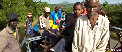 Ethnic Peul and supporters of Cellou Dalein Diallo leave Dabola town in northern Guinea on a commercial truck, 31 October 2010