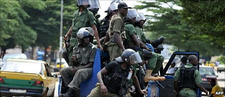 Policemen patrolling in a street following clashes in Conakry on 22 October 2010
